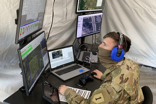 Spc. Nicholas Miller assigned to 1st Engineer Battalion, 1st Infantry Division, conducts flight operations through a laptop based ground control station during the FTUAS capabilities assessment at Fort Riley, Kansas, April 8, 2020