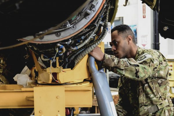 Spc. Ermias Mekonen from B Company, 1st General Support Aviation Battalion, 214th Aviation Regiment conducts 400 hours phase maintenance on an CH-47 Chinook helicopter at Katterbach Army Airfield, Germany, April 5, 2018. Phase maintenance inspections occur at regular intervals on all aircraft in order to keep them operational. (U.S. Army photo by Charles Rosemond)